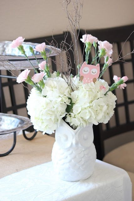 A Centerpiece Of White Owl Vase And Pink Blooms Cardboard