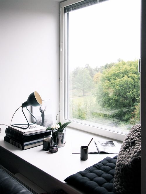 a comfy window sill seat with cushions to read and enjoy the views