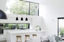 02 a minimalist white kitchen with a large skylight and a window backsplash with tropical greenery views