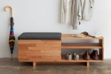 02 a modern wooden shelf with a drawer under the seat and open shelving is used as a bench