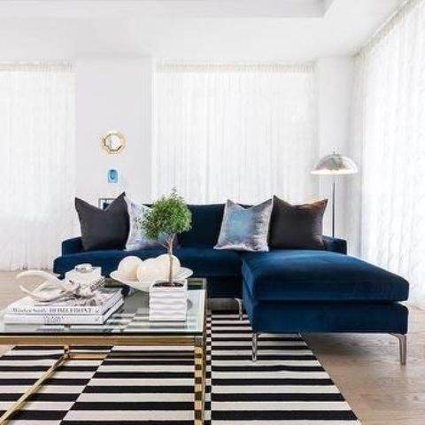 a sapphire blue velvet sectional sofa for a modern living room