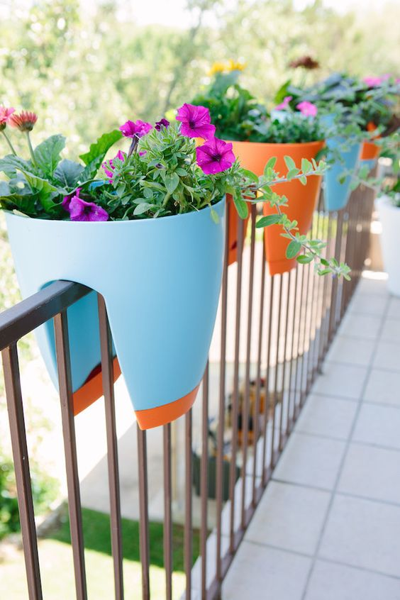 a smart planter design in bold colors can be put right on the railing
