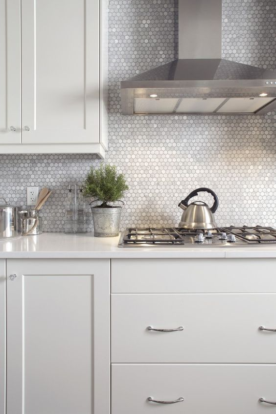 shiny silver hex tiles to make a neutral kitchen sparkle