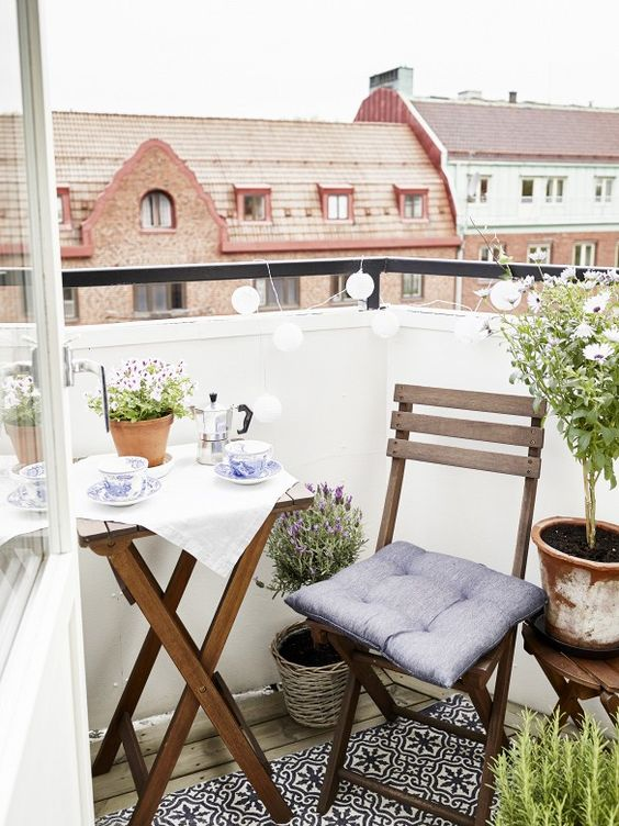 simple wooden folding furniture, baskets with plants for a Scandi breakfast nook