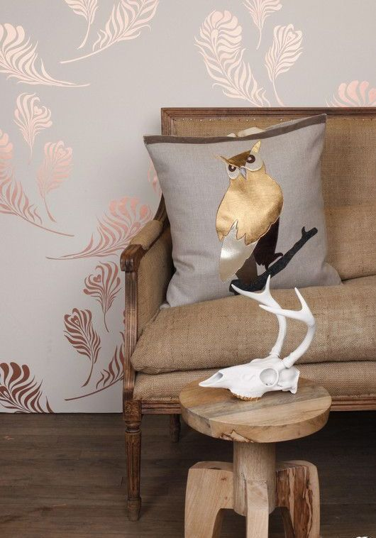 a chic pillow in brown with gold detailing looks elegant
