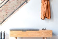03 a modern wooden bench with a storage surface and grey seat, a sotrage space under it