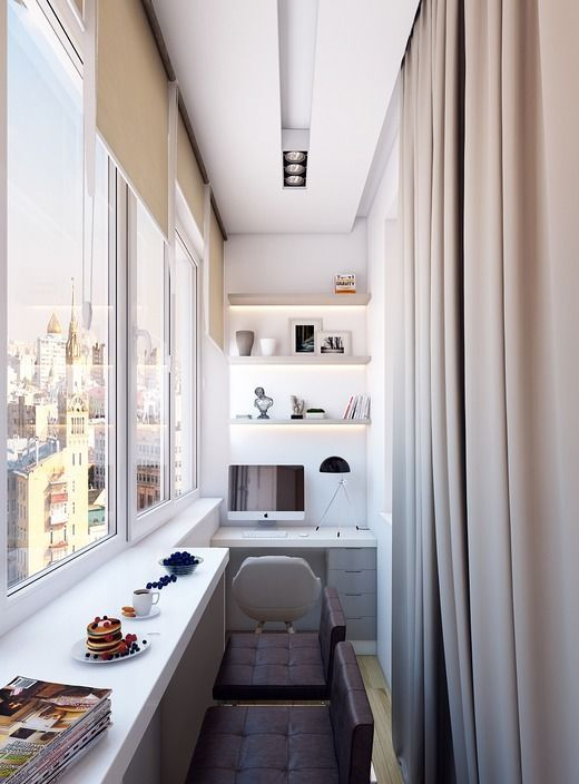 a narrow balcony turned into a minimalist home office with open lit up shelving, a desk and shutters, there's a breakfast space