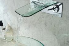 03 a sheer round glass sink and a glass faucet is ideal for a modern bathroom
