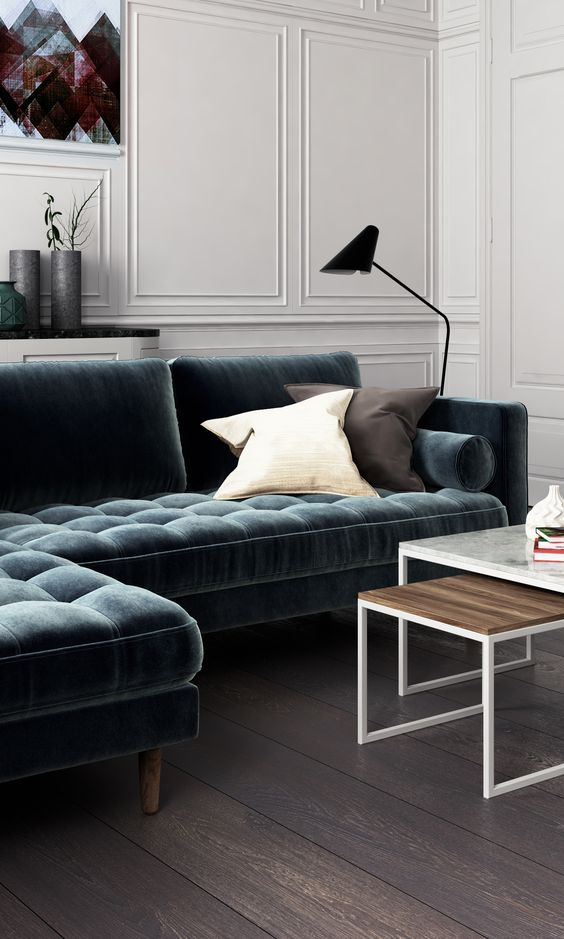 a slate grey blue velvet sofa for a moody living room