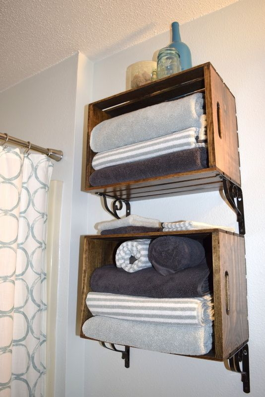 Stunning pallet box shelving units with towels next to the shower zone is a timeless solution