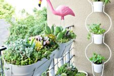 03 planters hung on the balcony railing is a creative and cool idea