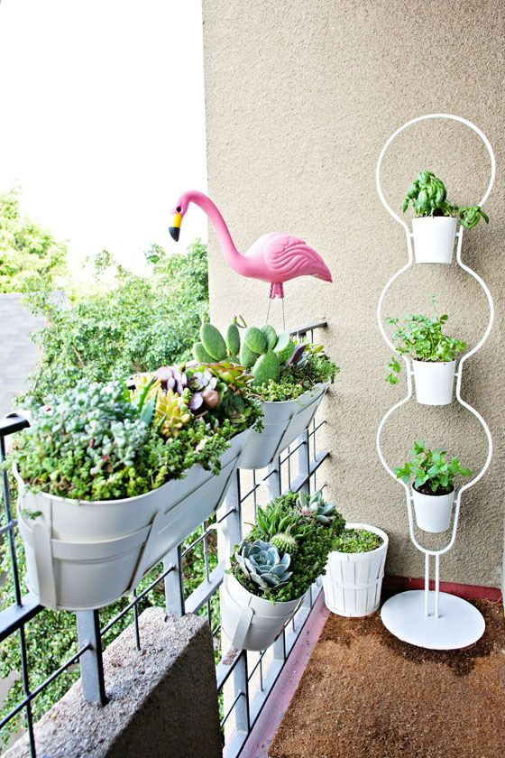 planters hung on the balcony railing is a creative and cool idea