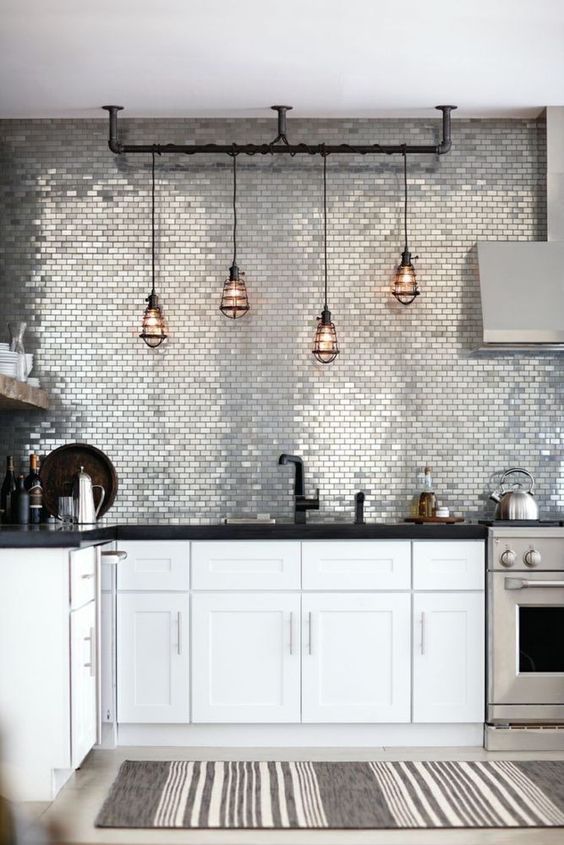 shiny silver tile backsplash looks wow and makes the monochrome kitchen stand out