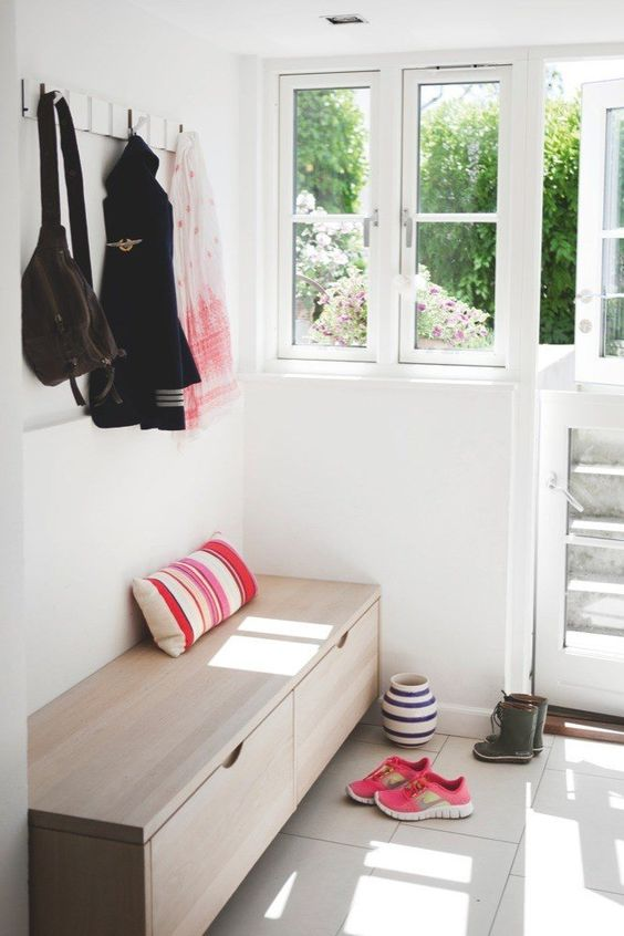 a simple wooden storage bench is a perfect solution for a tight space