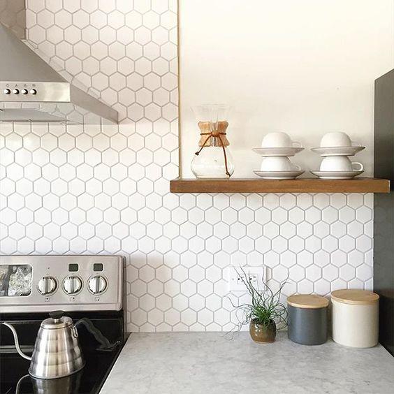 small hexagon tiles make a cool modern touch in the kitchen