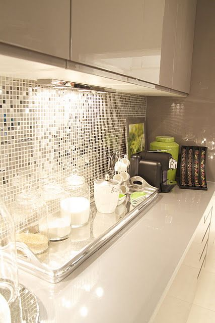 tiny tile mirror backsplash is a very glam option to spruce up any kitchen