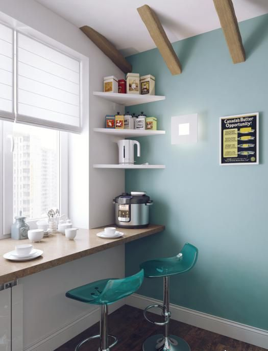 a cozy breakfast bar on the windowsill and a couple of modern teal stools
