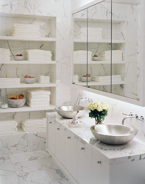 a marble bathroom with shiny silver bowl sinks for a luxurious modern look