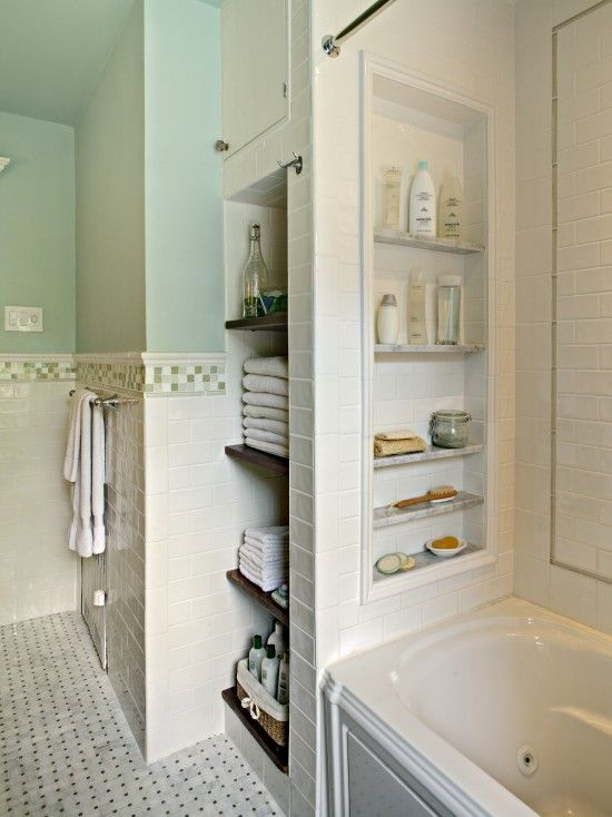built-in open shelving behind the bathtub and a built-in open shelf over it with various stuff