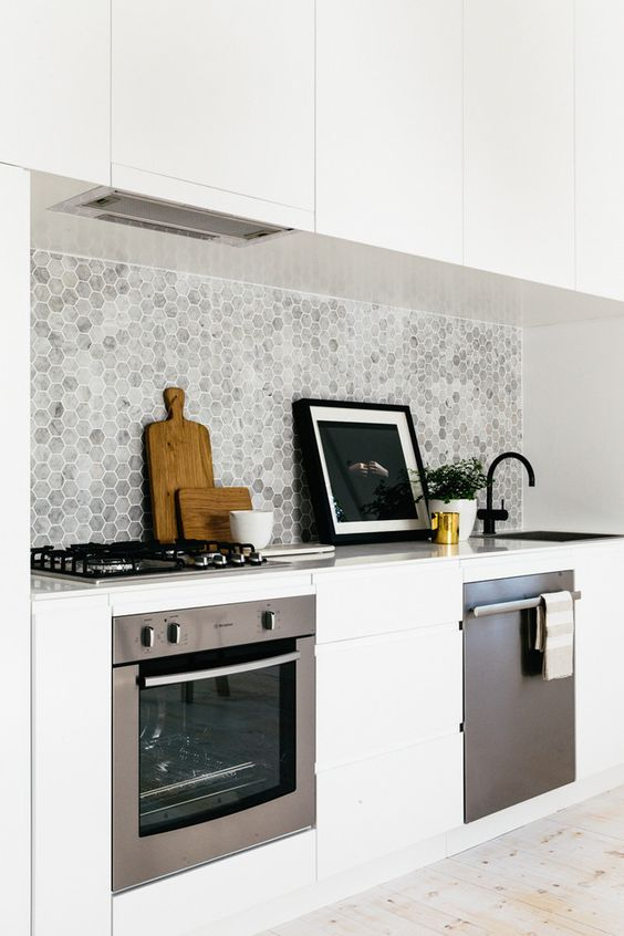 marble hexagon tiles make the kitchen look refined and chic