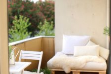 05 this balcony accomodates a breakfast nook and a small pallet daybed to lie on and read