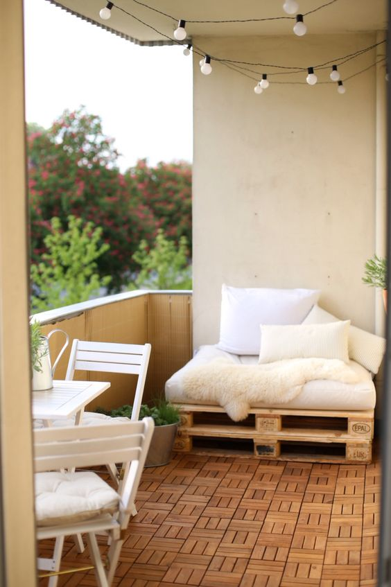 this balcony accomodates a breakfast nook and a small pallet daybed to lie on and read