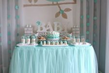 06 a dessert table with an owl backdrop in aqua color