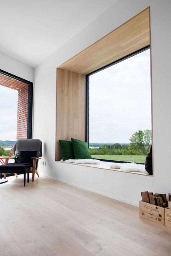 a panoramic window with a wide window sill, which is used for enjoying the views and reading