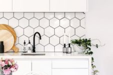 06 white hexagon tiles with black grout adds texture and interest
