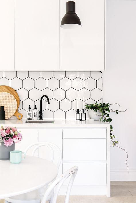 white hexagon tiles with black grout adds texture and interest