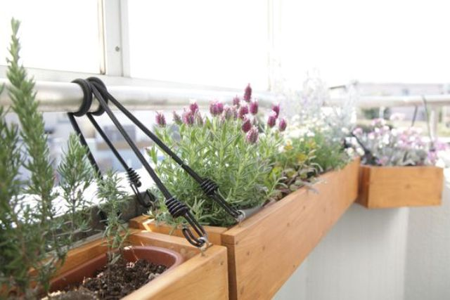 wooden planters hung on the railing won't take any space
