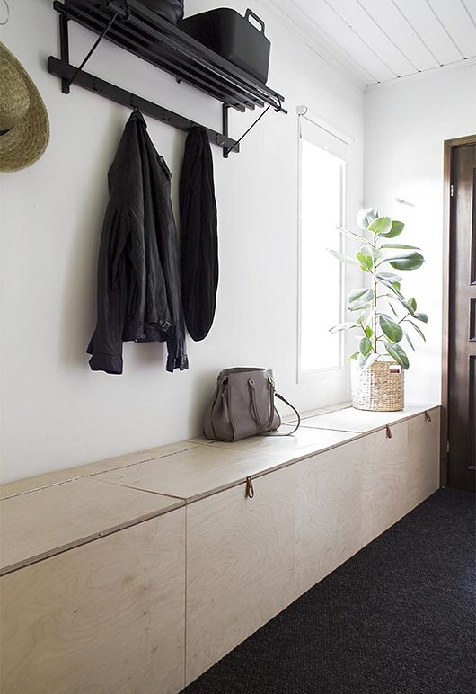 a built-in storage bench of plywood is very functional