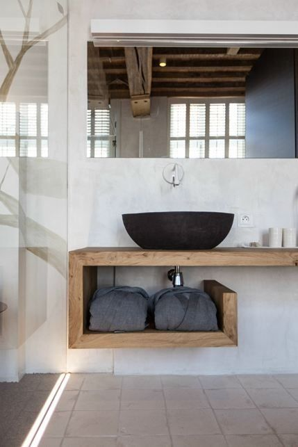 a matte black metal sink for a natural masculine bathroom