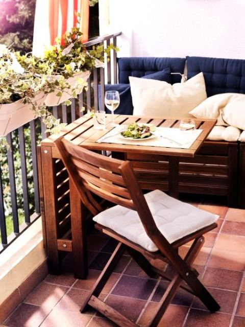 a pallet bench, a folding chair and table, rail hanging planters for a cozy balcony