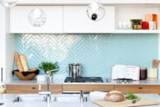 07 light blue herringbone tiles add a colorful touch to the neutral space
