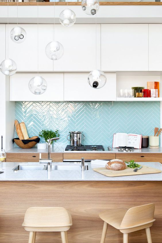 light blue herringbone tiles add a colorful touch to the neutral space