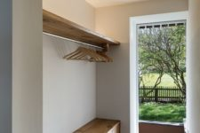 08 a built-in wooden storage bench is a practical piece