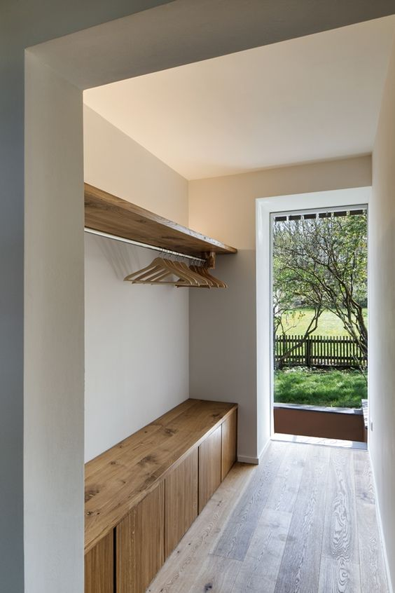 a built-in wooden storage bench is a practical piece