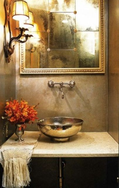 a gorgeous shiny hammered copper bowl sink for a vintage bathroom