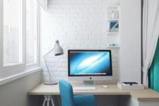 08 a modern white balcony with faux brick walls, a half-floating desk and a comfy blue chair