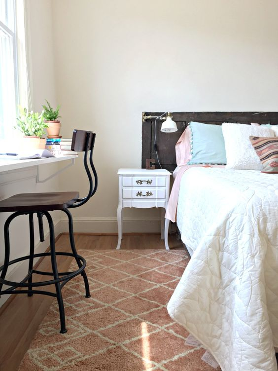 a narrow windowsill is used as a workspace as there's no other space in the bedroom
