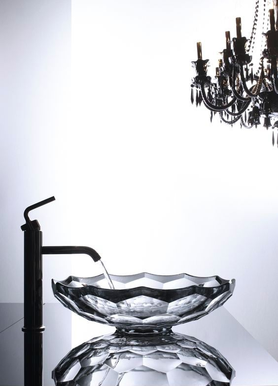 a refined faceted glass sink with a geo edge and a dark rim