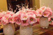 08 baby shower centerpiece of white owl vases and pink blooms
