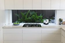 08 creamy minimalist cabinets with no handles give viws of a tropical backyard with much greenery