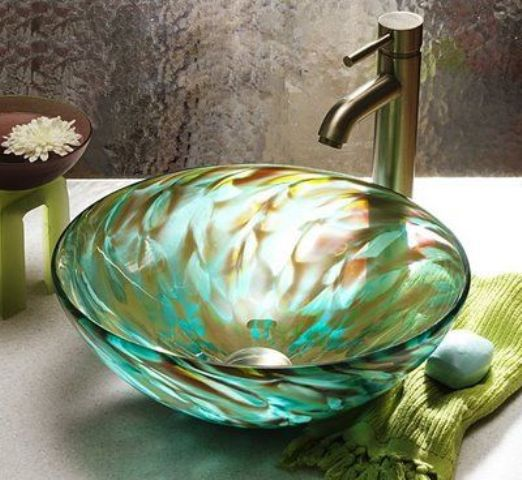 a beautiful swirl bowl sink in brown and emerald for a gorgeous statement