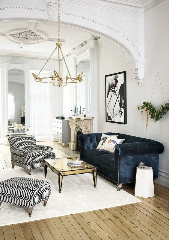 a chic space with luxurious touches with a dark blue velvet sofa
