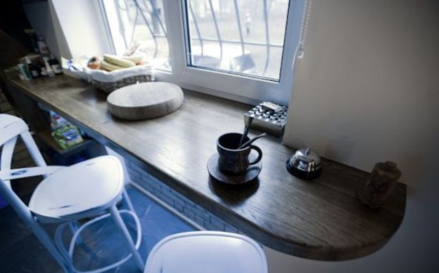 a windowsill used as a tabletop in the kitchen is a gorgeous idea for a small space