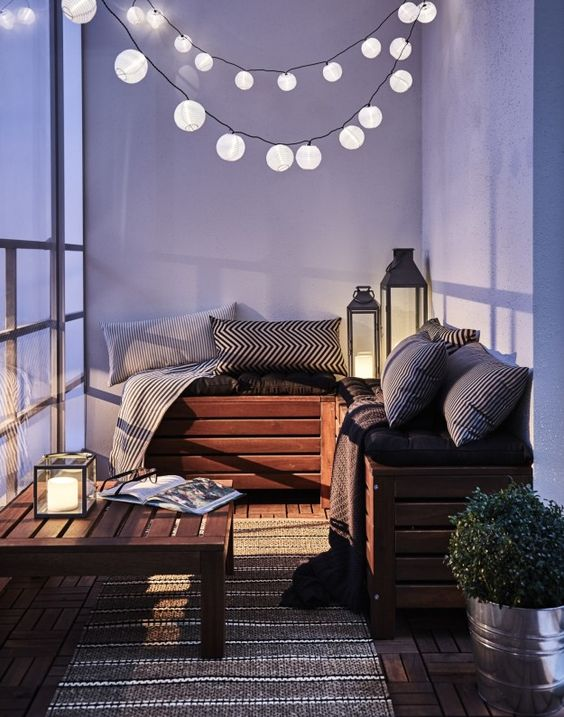 some strings of paper lanterns will light up the space and won't cost much