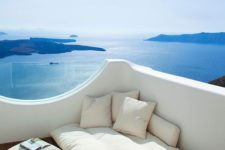 10 a balcony with a gorgeous sea view and a soft mattress and pillows to sleep