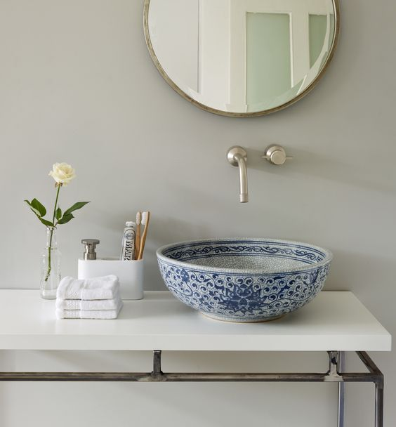 a beautiful blue porcelain sink with Moroccan patterns looks wow